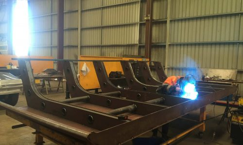 Truck tray head board being fabricated
