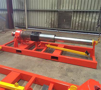 thrust cylinder storage and presenter for underground drilling raise bore rig