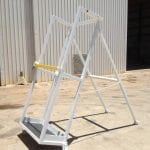 Vertical drill rod racks for underground drill rigs