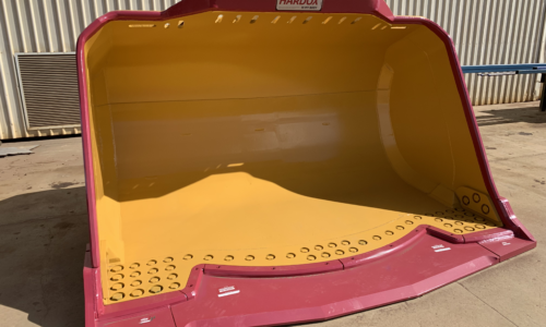 Underground Loader Buckets with Hardox in My Body quality accreditation sticker. Front view to show the smooth interior of the bucket with no boxed-out centre section. Alternative description: Underground mining bucket.