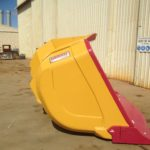 Outcast underground loader bucket showing underside of bucket floor stepped up lip plate