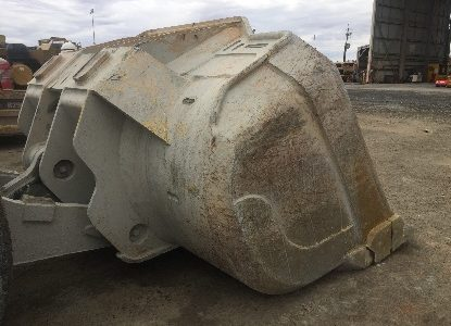 Rear/side view of Outcast underground loader bucket after use. Shows absence of structural damage in areas usually covered by heel shrouds.