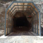 Looking through portal frame at entrance into underground mine